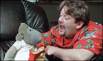 "ITV Digital - Screenshot from one of ITV Digital's adverts, featuring Johnny Vegas and the ""ITV Digital Monkey"""