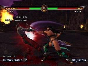 Mortal Kombat: Armageddon - The Xbox version gameplay screenshot, showing a fight between the zombie Liu Kang and Jade