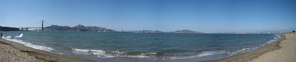 San Francisco Bay panorama with a view of sailboats, kite boarders, and the Crissy Field Beach.