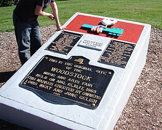 "Woodstock - Peace and Music Woodstock monument with plaques by sculptor Wayne C. Saward and erected in 1984 on the festival site. (Note that John Sebastian's surname is misspelled as ""Sabastian"")"