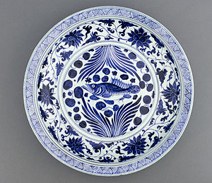 A Yuan Dynasty blue-and-white porcelain dish with fish and flowing water design, mid 14th century, Freer Gallery of Art.