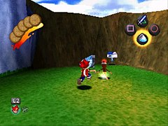 The player character (a young boy with a net) chases after a running ape. The head-up display elements are visible on-screen: cookies in the top left, the main button controls in the top right, and a zoom icon in the bottom left.
