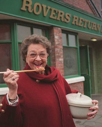 Betty Williams (Coronation Street) - Betty with her famous hotpot, outside The Rovers Return Inn.