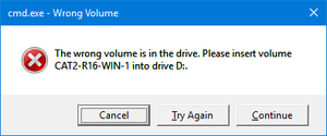 "Abort, Retry, Fail? - A screenshot of Wrong Volume dialog box on Windows 10. It is informing the user that an operation has failed because a disc that must be in the drive is missing. It is offering the user the choices of ""Cancel"", ""Try Again"" and ""Continue""."