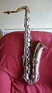 "Chu Berry - A silver-plated Conn 'New Wonder' Series II tenor saxophone, with a serial number which dates manufacture to 1934. It is a very late ""Transitional"" model tenor sax with split bell-keys, and was manufactured just before production of the Conn 10M started. Berry played a tenor saxophone almost identical to this one. However, the front of the bell of Berry's saxophone was more ornately engraved with various art deco designs."