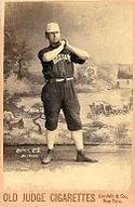 Joe Quinn posing in a Boston Beaneaters uniform.