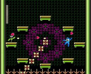 Mega Man - Mega Man battles a mini-boss from Mega Man 9. Note the run-and-gun and platform gameplay.
