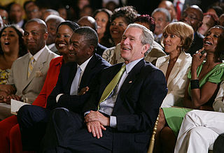 President George W. Bush, entrepreneur Bob Johnson, left, and invited guests respond to entertainers on June 22, 2007 in the East Room of the White House, in celebration of Black Music Month.