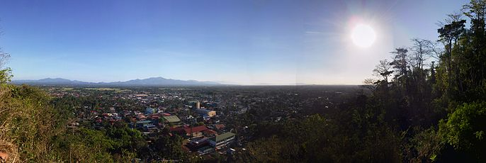 Rosario, Batangas skyline with the downtown on the foreground and rice fields (where Rosario is known for) and mountains on the background.