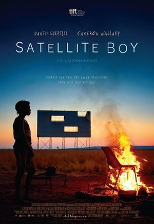 """Satellite Boy - Poster with the tagline: """"Courage can take you away from home. Love will lead you back."""""""