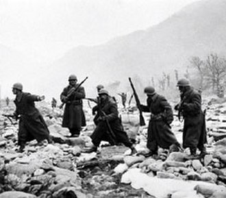 Military history of the Republic of Turkey - Members of the Turkish Brigade move into position in December 1950, shortly after suffering severe casualties attempting to block encirclement of the US 2nd Division at the Chongchon River in North Korea.