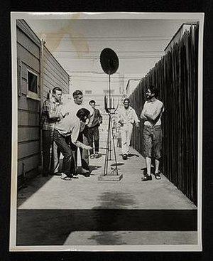 Wally Hedrick - Wallace Berman and other artists with 2 undercover Vice Squad officers, looking at Wally Hedrick's sculpture Sunflower (1952), during the now-famous LAPD obscenity arrest at Ferus Gallery in 1957. Hedrick's Sunflowers (1952) was one of the earliest West Coast sculptures made almost exclusively with junk or scrap metal.