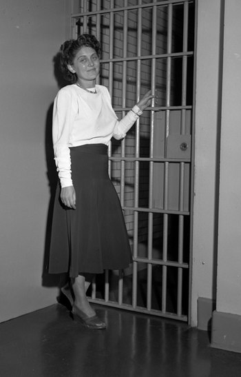 Dorothy Healey standing before jail cell in Lo...