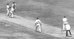 Chuck Fleetwood-Smith - Fleetwood-Smith (second from right) has England batsman Maurice Leyland caught at slip by Arthur Chipperfield, one of his ten wickets in the fourth Test at Adelaide Oval