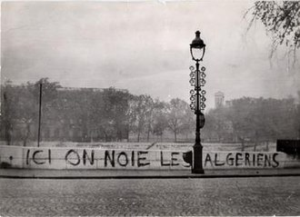 "Paris massacre of 1961 - Tagged on the Pont Saint-Michel in 1961: ""Ici on noie les Algériens"" (""Here we drown Algerians""). Dozens of bodies were later pulled from the River Seine."
