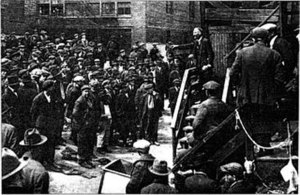 James Eads How - James Eads How (center right) speaking to unemployed in Chicago, 1921