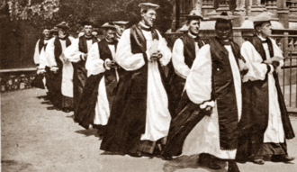 Long procession of mostly white clergymen in episcopal costume