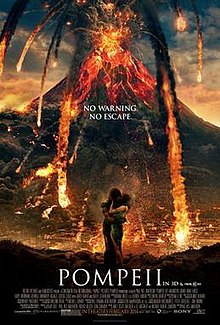 A Volcano erupting. In the foreground and a man and a woman are embracing. In the centre of the poster the tagline: No Warning. No Escape