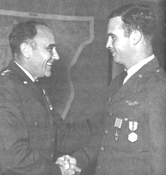 John Dale Ryan - Presenting Distinguished Flying Cross to his son, Captain Michael E. Ryan (right), 1969.
