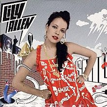 "A brunette young woman in a red dress that has ""Smile"" written all over it. The background contains ""Lily Allen"" and ""Smile"" written on top of a building with boomboxes, respectively under a cloud. She is wearing heart-shaped earrings."