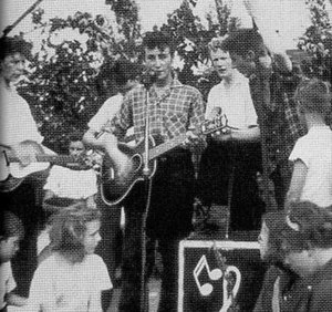 The Quarrymen - The famous photo of the Quarrymen playing at St. Peter's Church garden fête, where Lennon and McCartney first met. From left to right: Griffiths, Hanton, Davis, Lennon, Shotton, Garry