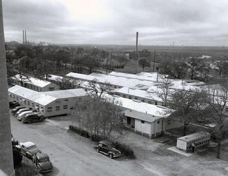University of Texas Southwestern Medical Center - Southwestern Medical College as it appeared at its founding in the 1940s. Animal facilities are seen in the lower right.