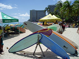 Surfboard - A stack of boards in Waikiki during a surf competition.