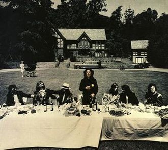 Living in the Material World (song) - Inner gatefold image from the Material World album, showing Harrison and his fellow musicians at a Last Supper-style banquet; photo by Ken Marcus
