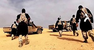 Al-Qaeda in the Islamic Maghreb - AQIM fighters in a propaganda video, filmed in the Sahara desert.