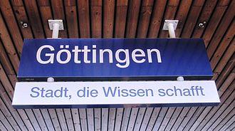 """University of Göttingen - Sign at Göttingen train station displaying the motto Stadt, die Wissen schafft (""""City that creates knowledge"""")."""