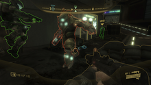 Two armored humans confront a large, bulky alien. Characters and terrain objects in the urban setting are outlined in yellow, red, or green. In the corners of the screen are head-up display information detailing location, health, and ammo.