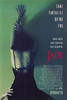 "A woman in an open back black dress, arm outstretched above her head, is leaning against a green wall. From below, another hand holds her at the waist. The top right of the poster features the tagline ""Some fantasies go too far."""