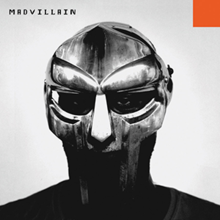 "Grayscale photo of Doom's face behind his metal mask, with word ""MADVILLAIN"" in pixelated black font at the top left corner and small orange square at the top right corner."