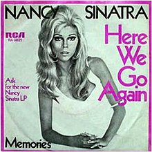 Black and white cover art photo of Nancy Sinatra on one elbow in a white dress. The border is purple as is some of the captioning. Captions says Nancy Sinatra in black. Side captions detail the record label and the song name in purple. The bottom caption has the B-side song name, Memories.