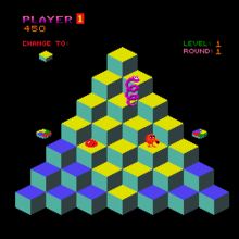 A square video game screenshot that is a digital representation of a multicolored pyramid of cubes in front of a black background. An orange spherical character, a red ball, and a purple coiled snake are on the cubes. Multicolored discs are adjacent to the left and right sides of the pyramid. Above the pyramid are statistics related to gameplay.
