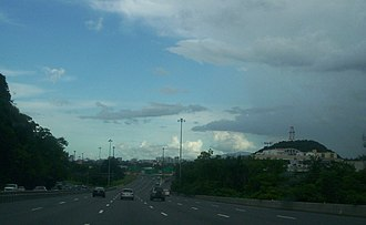 Puerto Rico Highway 22 - PR-22 enters the city of San Juan. The San Juan skyline is visible in the background.