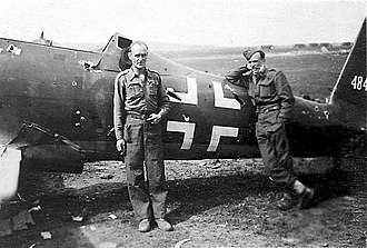 The March (1945) - Two survivors of the March pictured in front of a damaged Luftwaffe Arado Ar 96 at Celle Airfield on 18 April 1945.