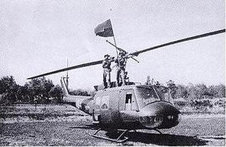 Battle of Ban Me Thuot - North Vietnamese soldiers pose on top of a captured South Vietnamese UH-1 helicopter at Phung Duc Airfield
