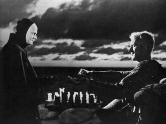 The Seventh Seal - Death and Antonius Block choose sides for the chess game; Death gets the black pieces.