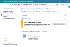 Security and Maintenance in Windows 10, reporting Storage Space issue in Maintenance section.