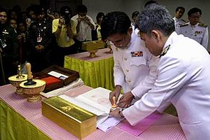 Emblem of Thailand - Rongpol Charoenpan, Cabinet Secretary, affixes the seals to the 2007 Constitution after it was signed by the King and countersigned by Meechai Ruchuphan, President of the National Legislative Assembly, on 24 August 2007.