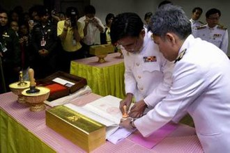 Emblem of Thailand - Cabinet Secretary affixes the seals to the 2007 Constitution after it was signed by the King and countersigned by the Parliament Speaker, 2007.
