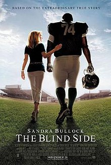 The Blind Side Film  Wikipedia The Blind Side A Relatively Small Blonde Women Stands Beside A Large  Football Player Facing Away From The