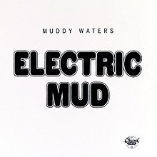 "Black and white cover art with ""ELECTRIC MUD"" in large capital letters, with a small ""MUDDY WATERS"" written above it"
