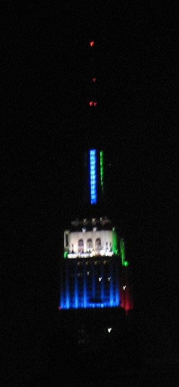 Empire State Building exhibiting decorative li...