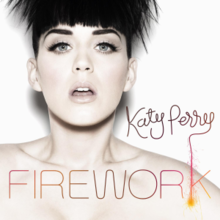 "A woman with short hair in front of a white background with ""Katy Perry"" written in brown and ""FIREWORK"" in orange text"