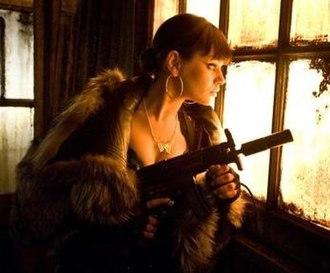 Mona Sax - Mila Kunis as Mona in the film