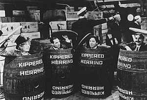 Monkey Business (1931 film) - The four Marx Brothers stowing away on an ocean vessel by hiding in barrels in this promotional still for Monkey Business. Left to right: Harpo, Zeppo, Chico, Groucho.