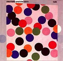 Scattered range of large coloured circles mostly red or black. The background in pink. Artist name is at top left with album name at top right.