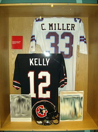 "Pro Football Hall of Fame - The ""Other Leagues"" display includes the USFL; inductee Jim Kelly's jersey is in the foreground."